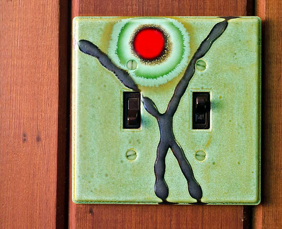 A decorative clay switch plate, part of Josh Blanc' Cosmic Cloud series of artisan tiles, at the home of Sheila Menzies and Joe Taylor, co-founders of the Tile Heritage Foundation, in Healdsburg, CA on October 17, 2012.