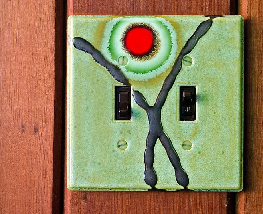 A decorative clay switch plate, part of Josh Blanc' Cosmic Cloud series of artisan tiles, at the home of Sheila Menzies and Joe Taylor, co-founders of the Tile Heritage Foundation, in Healdsburg, CA on October 17, 2012. Photo: Alvin Jornada, Special To The Chronicle