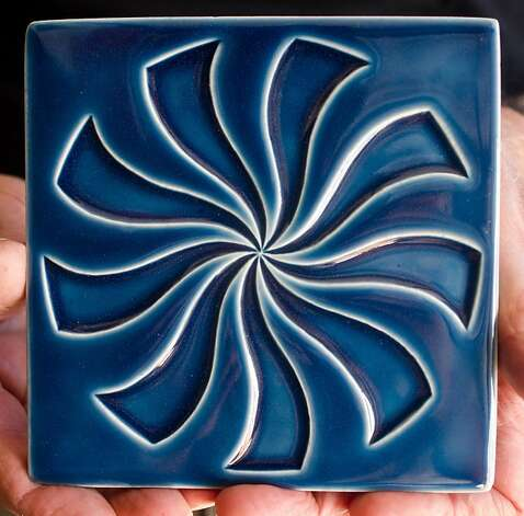 Joe Taylor holds a decorative tile created by the Starbuck/Goldner Studio, of Bethlehem, Pennsylvania, at the Tile Heritage Foundation in Healdsburg, CA on October 17, 2012. Photo: Alvin Jornada, Special To The Chronicle
