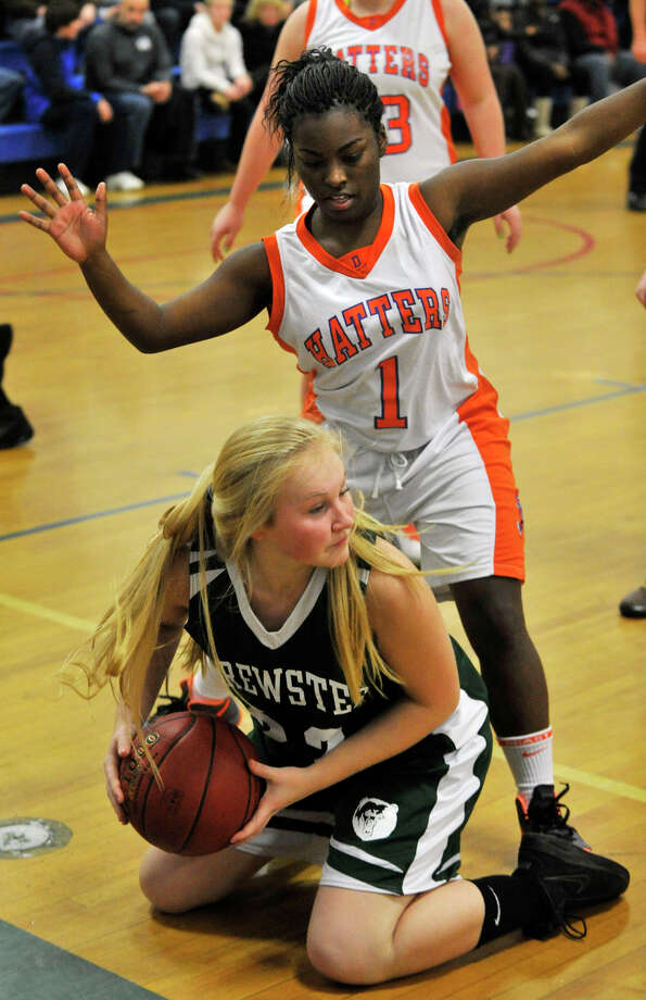Danbury's Nahla Ward pressures Brewster's Samantha Chiudina as she looks for an open teammate during The News-Times Greater Danbury Holiday Festival championship game at the Danbury War Memorial on Friday, Dec. 28, 2012. Danbury won, 53-24. Photo: Jason Rearick / The News-Times