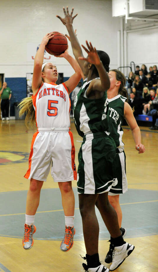 Danbury's Rachel Gartner puts up a shot over Brewster's Jazmin Pryce, foreground, and Brittany Deieso during The News-Times Greater Danbury Holiday Festival championship game at the Danbury War Memorial on Friday, Dec. 28, 2012. Danbury won, 53-24. Photo: Jason Rearick / The News-Times