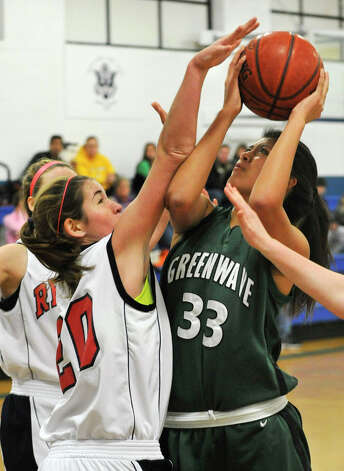 New Milford's Emily Llerena shoots while under pressure from New Fairfield's Katie Broderick during The News-Times Greater Danbury Holiday Festival consolation game at the Danbury War Memorial on Friday, Dec. 28, 2012. New Fairfield won, 52-38. Photo: Jason Rearick / The News-Times