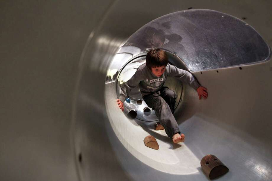 Peter McCaffrey walks down a climbing tube in upper lever of the first Angry Birds Space attraction in the U.S., which is located at the Kid's Space Place in Space Center Houston. Photo: Mayra Beltran, Houston Chronicle / © 2012 Houston Chronicle