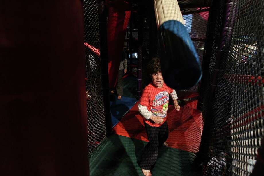 Andrew McCaffrey kicks punching bags in the upper level of the first Angry Birds Space attraction in the U.S. Photo: Mayra Beltran, Houston Chronicle / © 2012 Houston Chronicle