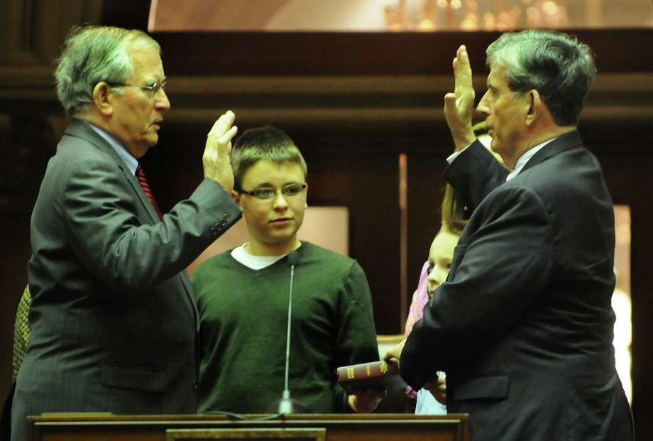 Michael Breslin, left, administers the Oath of Office to his brother state Sen. Neil Breslin on Friday, Dec. 28, 2012, at the Capitol in Albany, N.Y. (Cindy Schultz / Times Union)l Photo: Cindy Schultz / 00020597A