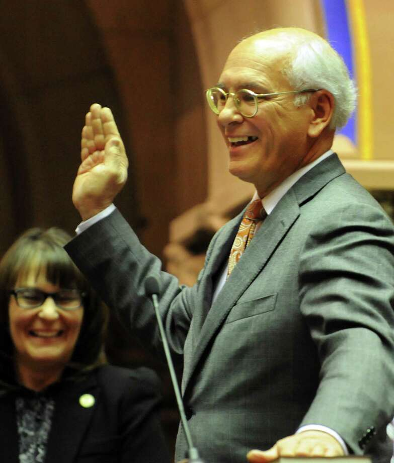 Rep. Paul Tonko laughs as he stumbles on the words to the Oath of Office during the swearing-in ceremony on Friday, Dec. 28, 2012, at the Capitol in Albany, N.Y. (Cindy Schultz / Times Union) Photo: Cindy Schultz / 00020597A