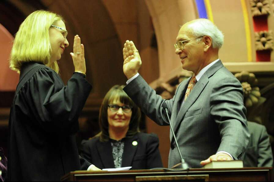 Judge Christine Clark, left, administers the Oath of Office to Rep. Paul Tonko during the swearing-i
