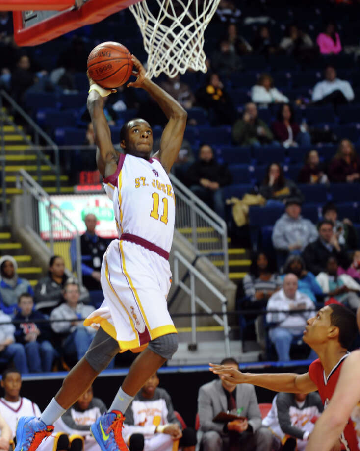 St. Jospeh's #11 Quincy McKnight prepares to slam dunk the ball, during the Northeast Christmas Classic basketball tournament action against LaSalle Academy at Webster Bank Arena in Bridgeport, Conn. on Frday December 28, 2012. Photo: Christian Abraham / Connecticut Post