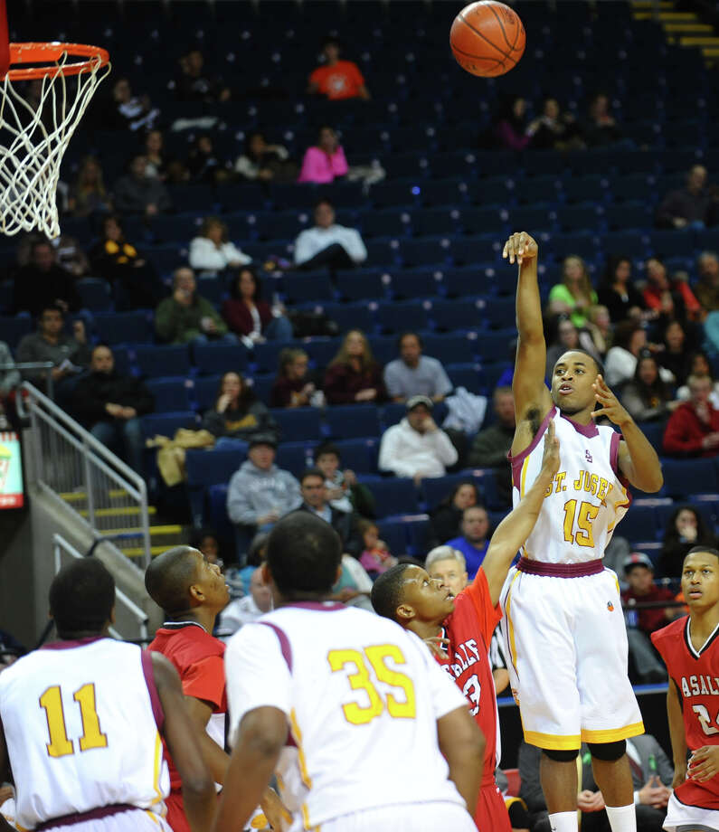 St. Joseph's #15 Denzel Moscova attempts a shot during Northeast Christmas Classic basketball tournament action against LaSalle Academy at Webster Bank Arena in Bridgeport, Conn. on Frday December 28, 2012. Photo: Christian Abraham / Connecticut Post