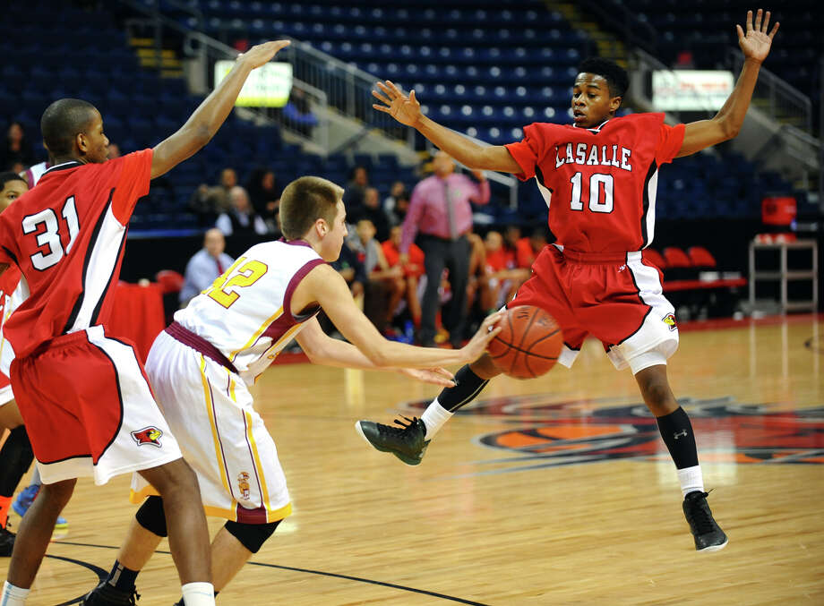 St. Joseph's #42 Rich Kelly passes the ball as LaSalle Academy 's #10 Dwayne Pow tries to block, during Northeast Christmas Classic basketball tournament action at Webster Bank Arena in Bridgeport, Conn. on Frday December 28, 2012. Photo: Christian Abraham / Connecticut Post