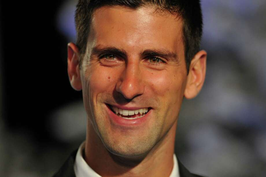 World number one tennis player Serbia's Novak Djokovic arrives at the Winter Whites Gala in aid of the Centrepoint charity at the Royal Albert Hall in central London on December 8, 2012. The charity gala in conjunction with the Statoil Masters tennis event was attended by Centrepoint patron Prince William, Duke of Cambridge. AFP PHOTO / CARL COURTCARL COURT/AFP/Getty Images Photo: CARL COURT, Stringer / AFP