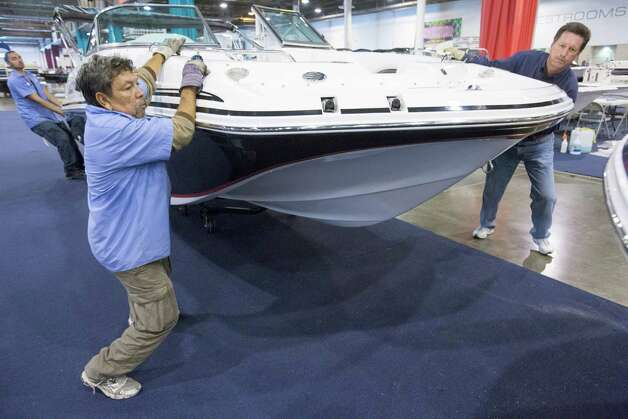 Pepe Narvaez, left, and Dave Foulkrod help push a boat into place. Photo: Eric Kayne, For The Chronicle / © 2012 Eric Kayne