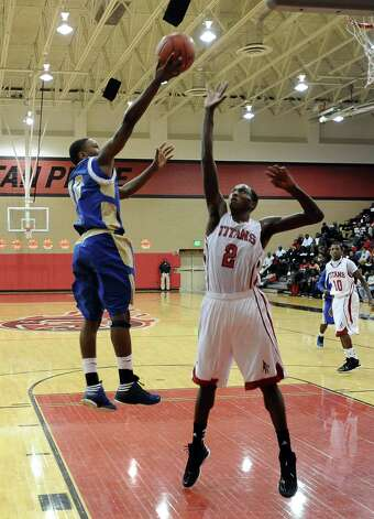 Ozen player Ryan Haynes, #10, puts it up for two during the Memorial High School Titans basketball game against the Ozen High School Panthers on Friday, December 28, 2012, at the James Gamble Boys Basketball Tournament semi-finals held at Port Arthur Memorial High School. Ozen won over Memorial 69 - 54. Photo taken: Randy Edwards/The Enterprise