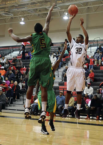 Central player Andre' Morris, #32, puts it up for two during the Central High School Jaguars basketball game against the Washington-Marion High School Charging Indians on Friday, December 28, 2012, at the James Gamble Boys Basketball Tournament semi-finals held at Port Arthur Memorial High School. Central won over Washington-Marion 60- 42. Photo taken: Randy Edwards/The Enterprise