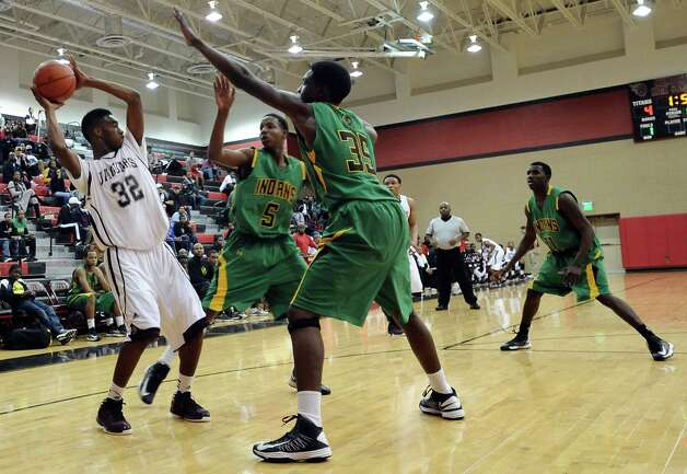 Central player Andre' Morris, #32, looks for an open teammate during the Central High School Jaguars basketball game against the Washington-Marion High School Charging Indians on Friday, December 28, 2012, at the James Gamble Boys Basketball Tournament semi-finals held at Port Arthur Memorial High School. Central won over Washington-Marion 60- 42. Photo taken: Randy Edwards/The Enterprise