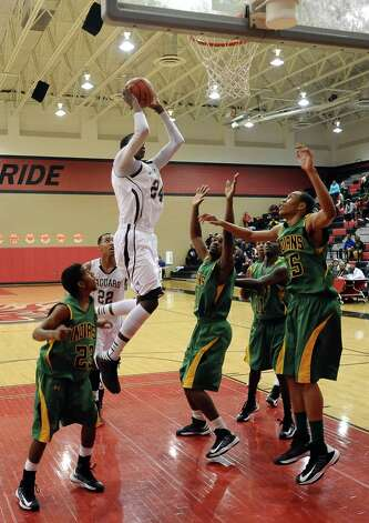 Central player E'Torrion Wilridge, #24, puts it up for two during the Central High School Jaguars basketball game against the Washington-Marion High School Charging Indians on Friday, December 28, 2012, at the James Gamble Boys Basketball Tournament semi-finals held at Port Arthur Memorial High School. Central won over Washington-Marion 60- 42. Photo taken: Randy Edwards/The Enterprise