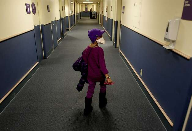 Eman finds her way around Children's Hospital quite easily in Oakland, Calif.  on Thursday Nov. 29, 2012. 8-year-old Eiman Abdullah Alqattan from Kuwait came to Children's Hospital to cure her sickle cell disease with a bone marrow transplant. She is well on her way to recovery after the sucessful treatment. Photo: Michael Macor, The Chronicle
