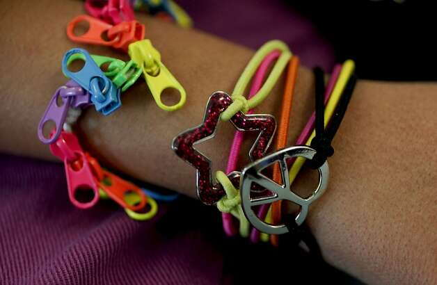 Eman, who loves to shop, shows off some of the bracelets she has bought. Photo: Michael Macor, The Chronicle
