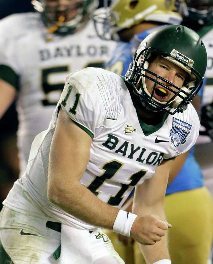 Baylor quarterback Nick Florence celebrates one of his three touchdowns. Photo: Lenny Ignelzi, STF / AP