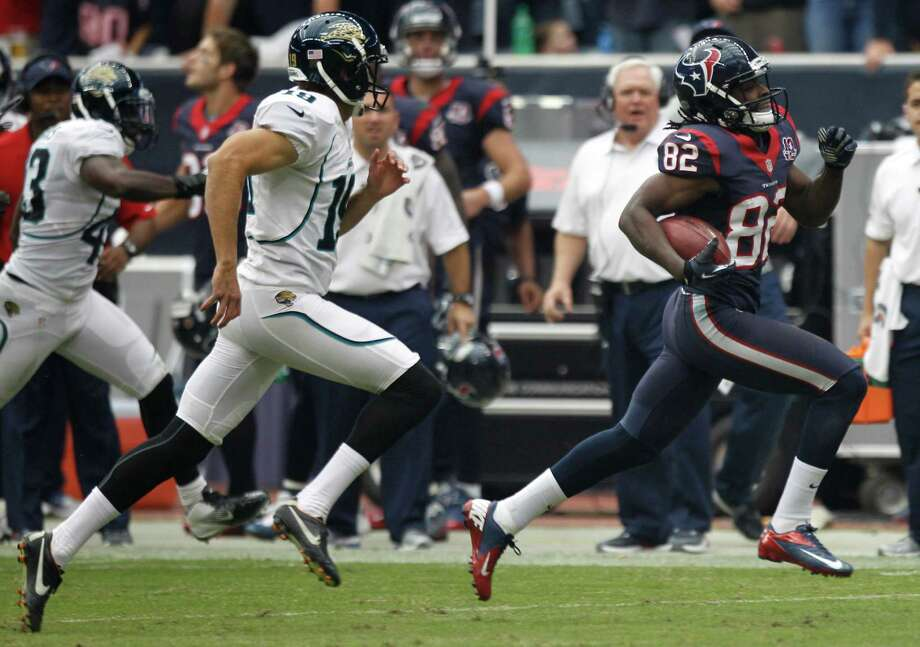 Texans wide receiver Keshawn Martin, right, is chased by Jacksonville punter Bryan Anger, left, on a 71-yard punt return. Martin has proved to be a solid returner after the departure of Trindon Holliday. Photo: Brett Coomer, Staff / © 2012  Houston Chronicle