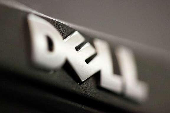 In this Aug. 15, 2011 photo, the logo on a Dell computer is displayed, in Philadelphia. Dell announced Monday, July 3, 2012, that it is buying Quest Software for about $2.36 billion, ending recent speculation about who the unnamed bidder was in a battle for the company with investment firm Insight Venture Partners.  (AP Photo/Matt Rourke)