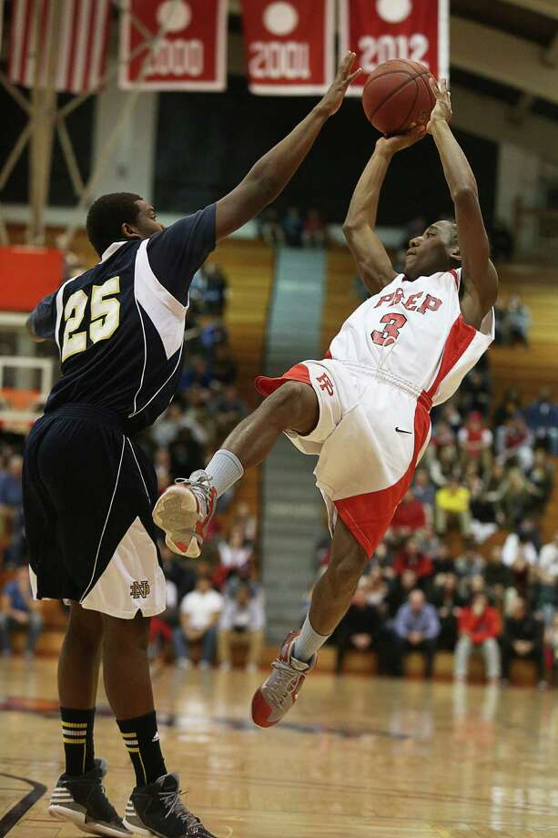 Mike Ross Connecticut Post freelance -Fairfield Prep's #3 Keith Pettway fades away and shots over Notre Dame of Fairfield #25 Kevin Lang during first half action of the Holiday Classic final on Friday evening. Photo: Mike Ross / @www.mikerossphoto.com