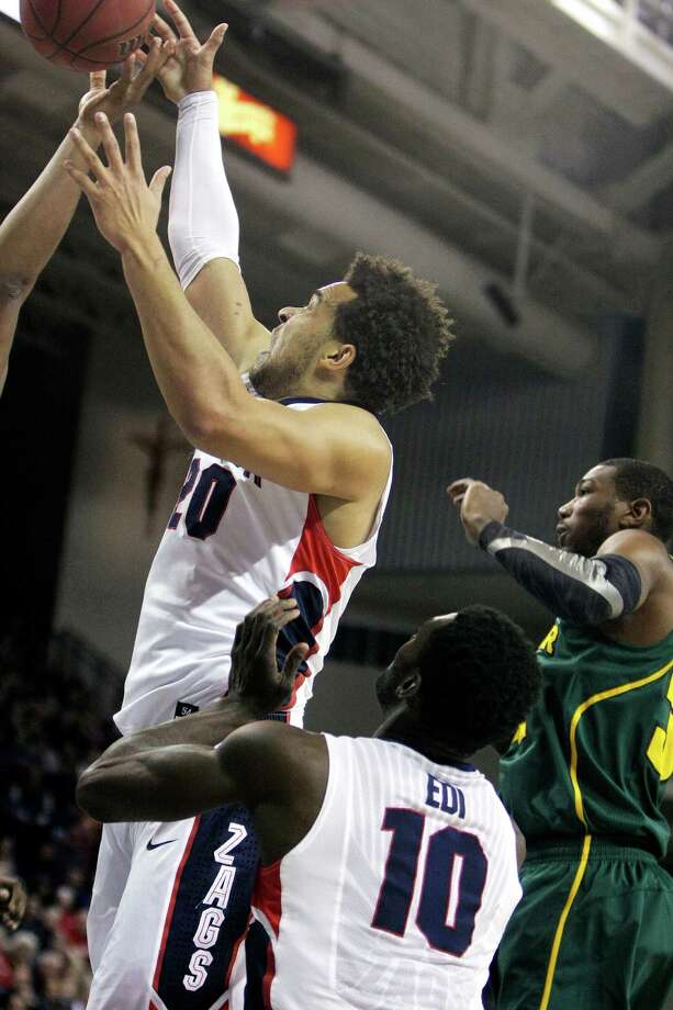 Gonzaga's Elias Harris, left, goes after a rebound during the first half of an NCAA college basketball game against Baylor in Spokane, Wash., on Friday, Dec. 28, 2012. (AP Photo/Young Kwak) Photo: Young Kwak