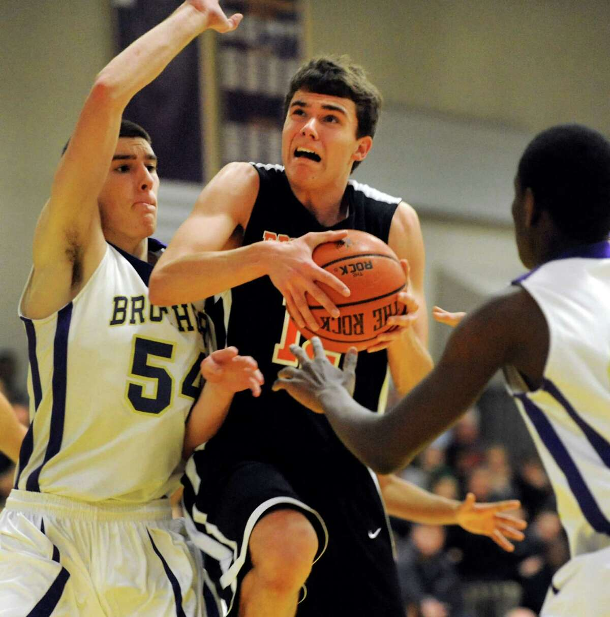 Bethlehem's John Sica (12), center, goes to the hoop as CBA's Greig Stire (54) defends during their basketball game on Friday, Dec. 28, 2012, at Christian Brothers Academy in Colonie, N.Y. (Cindy Schultz / Times Union)