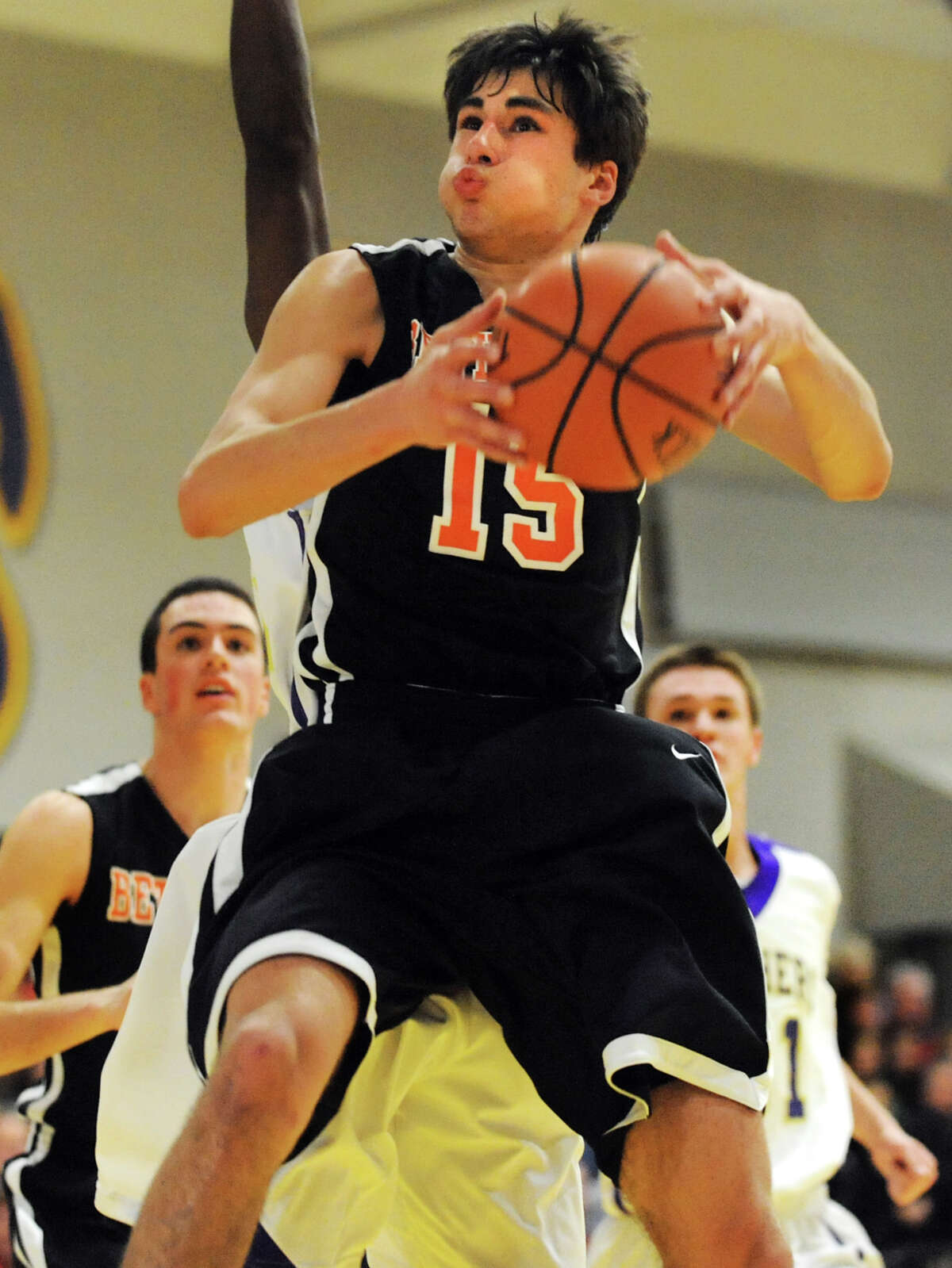 Bethlehem's Myles Bergere (15) grabs a rebound during their basketball game against CBA on Friday, Dec. 28, 2012, at Christian Brothers Academy in Colonie, N.Y. (Cindy Schultz / Times Union)