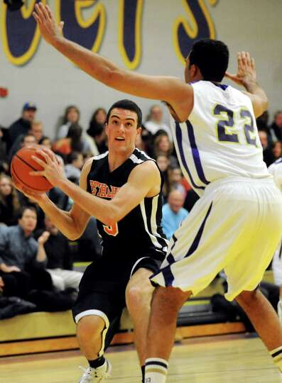 Bethlehem's Joe Giacone (5) looks to shoot as CBA's Nathaniel Robinson (22) defends during their bas