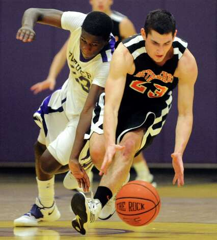 CBA's Daniel Owens (23), left, and Bethlehem's Nathan Kane (23) chase a loose ball during their basketball game on Friday, Dec. 28, 2012, at Christian Brothers Academy in Colonie, N.Y. (Cindy Schultz / Times Union) Photo: Cindy Schultz / 00020580A
