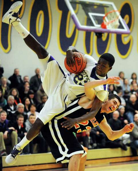 CBA's Daniel Owens (23), top, and Bethlehem's Nathan Kane (23) collide during their basketball game