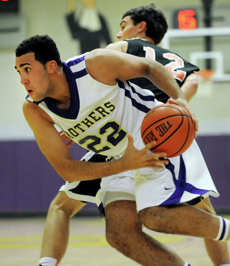 CBA's Nathaniel Robinson (22), left, drives past Bethlehem's John Sica (12) during their basketball