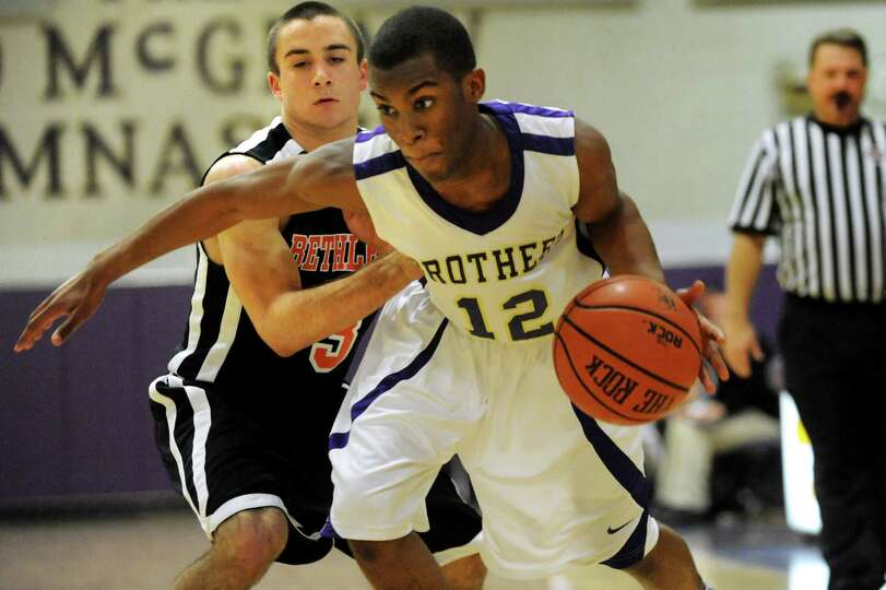 CBA's Tyrell Ramsey (12), right, drives past Bethlehem's Mike Graves (3) during their basketball gam