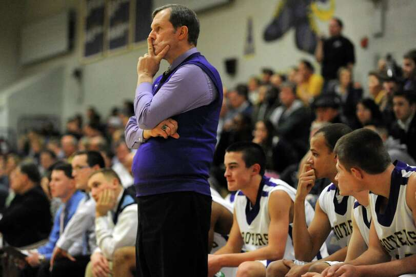CBA's coach Dave Doemel watches his players on the court during their basketball game against Bethle