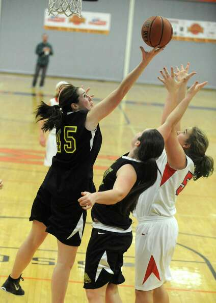 Berne Knox's Mary Salo gets her fingers on a rebound during a basketball game against Maple Hills at