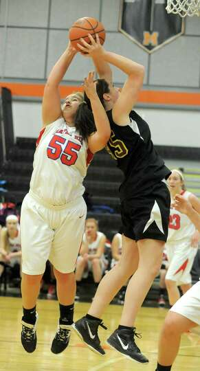 Maple Hills' Elizabeth Briggs goes up for a rebound with Berne Knox's Mary Salo during a basketball