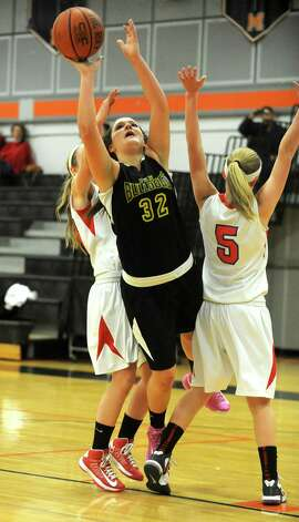 Berne Knox's Liz Harvey drives to the hoop during a basketball game against Maple Hills at Mohonasen High School on Friday Dec. 28, 2012 in Albany, N.Y. (Lori Van Buren / Times Union) Photo: Lori Van Buren