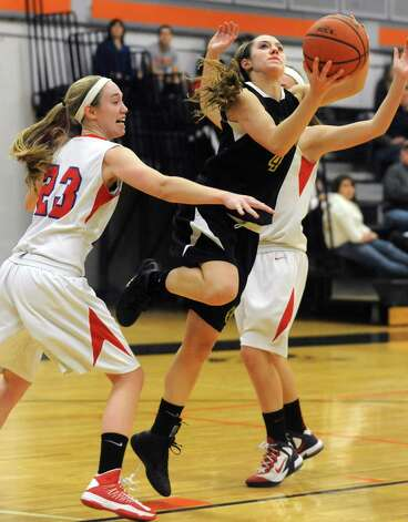 Berne Knox's Sarah Abbott slips her way through Maple Hill's Lindsay Mannion, left, and Anna Despart to make a layup during a basketball game at Mohonasen High School on Friday Dec. 28, 2012 in Albany, N.Y. (Lori Van Buren / Times Union) Photo: Lori Van Buren