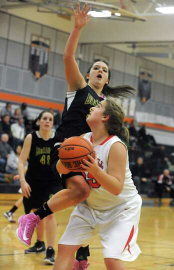 Berne Knox's Liz Harvey tries to stop Maple Hills' Elizabeth Briggs from scoring during a basketball