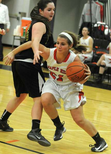 Maple Hills' Bella Nelson drives to the basket during a basketball game against Berne Knox at Mohona