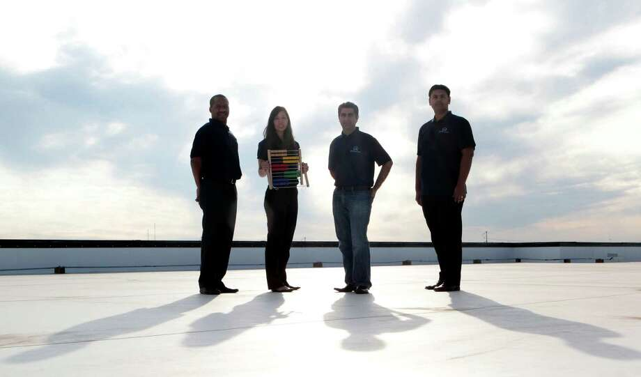 Founders of Olympus Math from left, Malik Mott, Emmie Chang, Javid Jamae and Muj Naqvi, pose for a portrait Tuesday, Dec. 11, 2012, in Houston. Olympus Math is a math software for students in grades 6 through 12. ( James Nielsen / Chronicle ) Photo: James Nielsen, Staff / © Houston Chronicle 2012