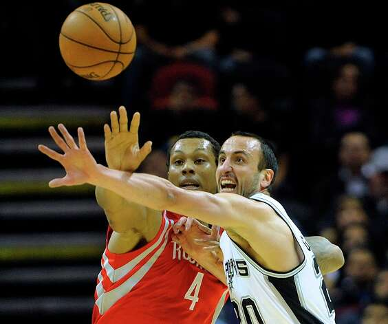 Manu Ginobili, right, of the San Antonio Spurs, and Greg Smith of the Houston Rockets battle for a loose ball during NBA action at the AT&T Center on Friday, Dec. 28, 2012. Photo: Billy Calzada, San Antonio Express-News / SAN ANTONIO EXPRESS-NEWS