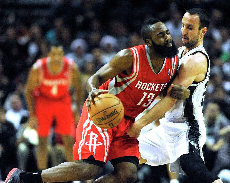 James Hardin of the Rockets (left) drives as Manu Ginobili of the Spurs defends at the AT&T Center on Friday, Dec. 28, 2012. Photo: Billy Calzada, San Antonio Express-News / SAN ANTONIO EXPRESS-NEWS