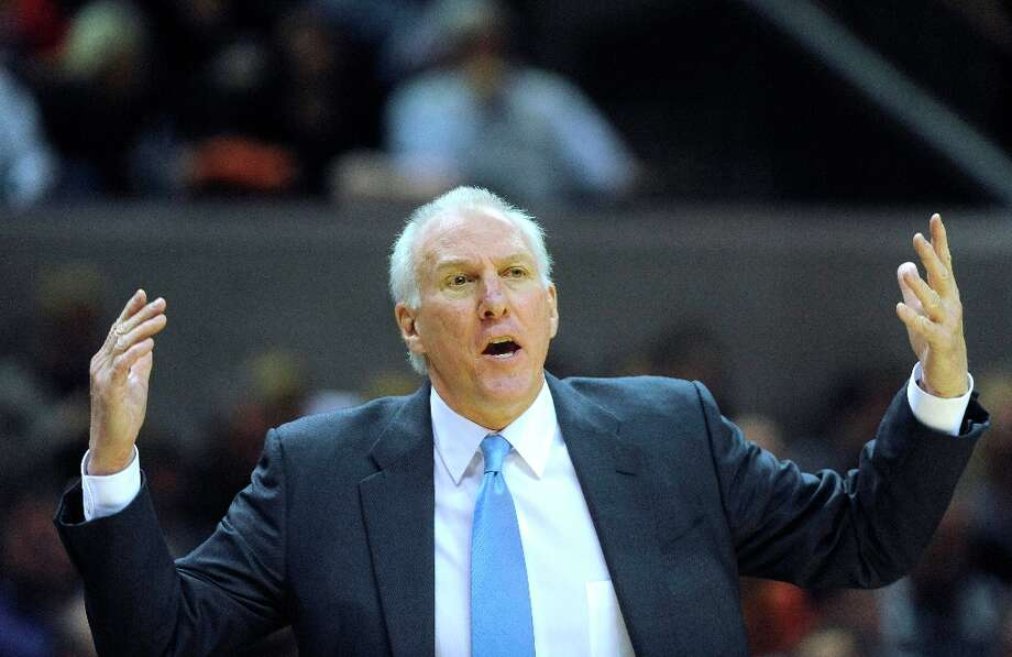 Spurs coach Gregg Popovich gestures to an official during action against the Houston Rockets at the AT&T Center on Friday, Dec. 28, 2012. Photo: Billy Calzada, San Antonio Express-News / SAN ANTONIO EXPRESS-NEWS