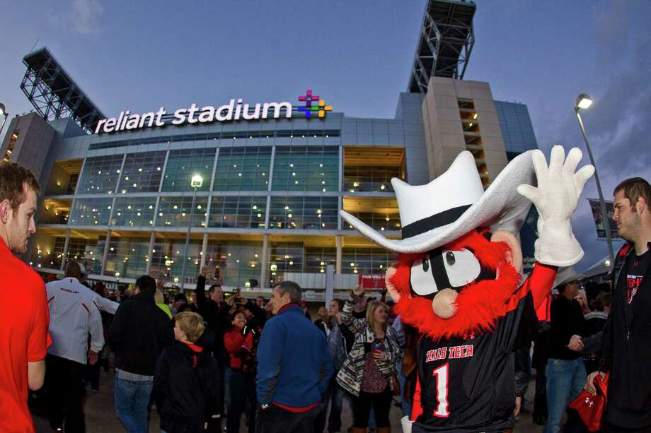 The Texas Tech contingent, mascot and all, made its presence felt Friday night at Reliant Stadium for the Meineke Car Care Bowl of Texas. Photo: Nick De La Torre, Staff / © 2012  Houston Chronicle