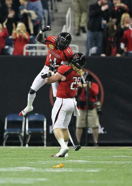 Texas Tech kick returner Jakeem Grant (11) celebrates his touchdown run with Blake Dees during the f
