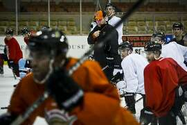 Pat Curcio, coach, general manager, and president of the San Francisco Bulls hockey team, conducts practice at the Cow Palace in Daly City, Calif., on Dec. 20, 2012.