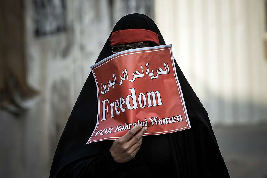 A Bahraini Shiite Muslim woman takes part in an anti-government protest in solidarity with jailed Bahraini women in the village of Mahaza, in Sitra, south of Manama on December 27, 2012. A Bahraini appeals court commuted to life imprisonment the death sentences of two Shiites convicted of killing two policemen during last year's unrest, lawyers said.  Photo: Mohammed Al-shaikh, AFP/Getty Images