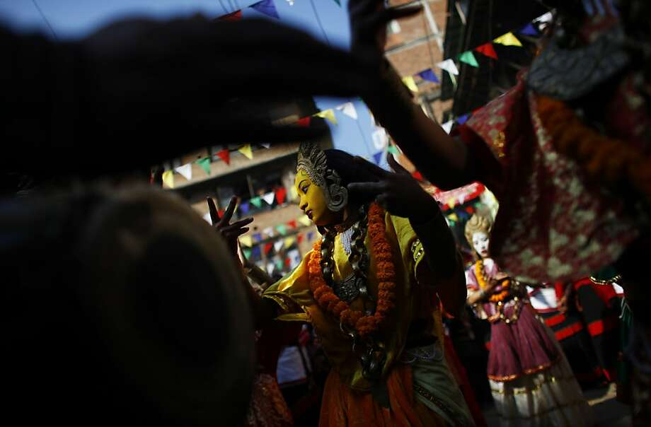 A Newar community girl dressed as a deity dances as she participates in a parade marking Yomari Puni festival in Katmandu, Nepal, Friday, Dec. 28, 2012. Yomari Puni is a festival observed annually by the Newari community on a full moon day where Yomari, a confection of rice flour, is prepared and eaten.  Photo: Niranjan Shrestha, Associated Press